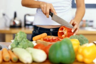 A woman preparing and chopping vegetables