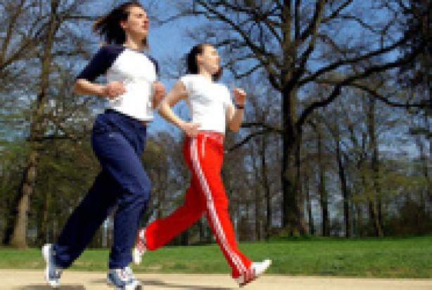 Two women jogging outdoors