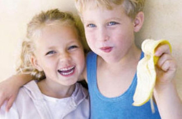 Children eating a banana