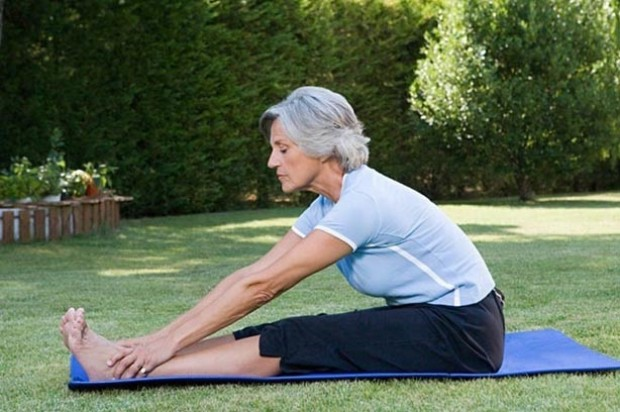 Exercise For Your Age Group woman stretch yoga elderly
