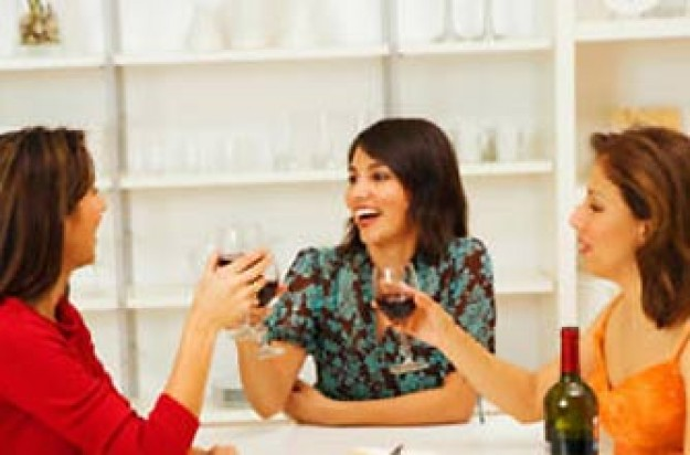 Three women drinking wine in a restaurant