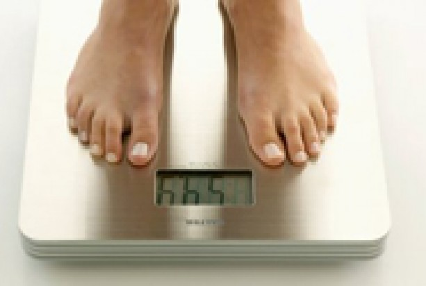 Someone weighing themselves on digital bathroom scales
