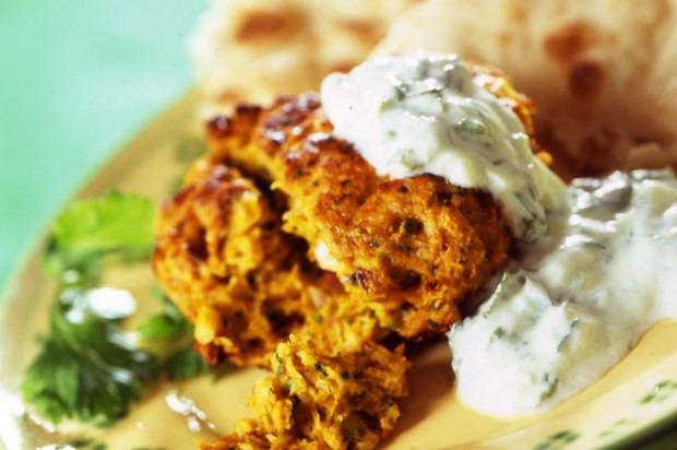 Tikka kebab with naan bread and raita