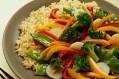 A plate of brown rice and stir-fry vegetables