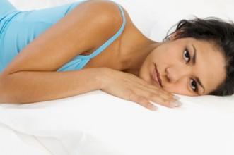 Why am I bleeding woman sad depressed early pregnancy