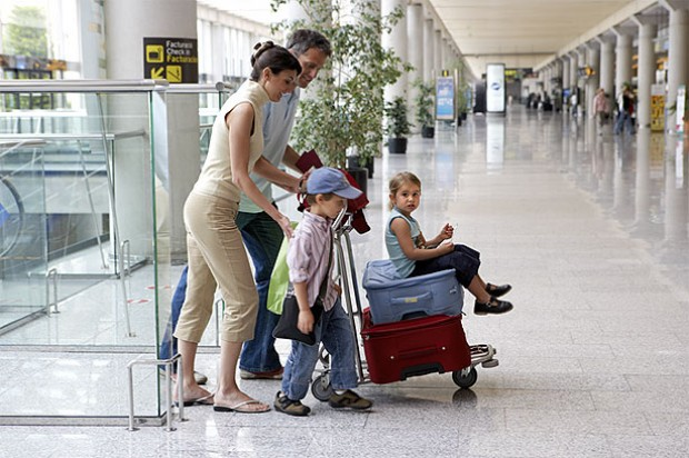 Travelling toddler family airport holiday