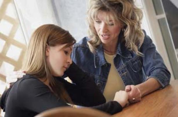 mum and teenage daughter talking