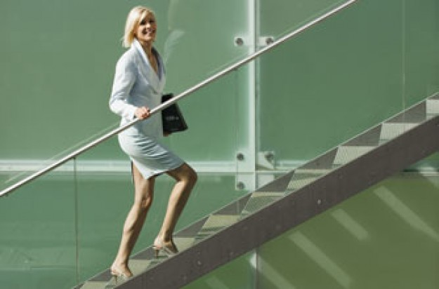 Easy tips to stay slim woman walking up stairs