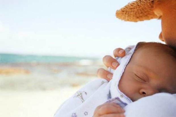 Baby protect sun woman