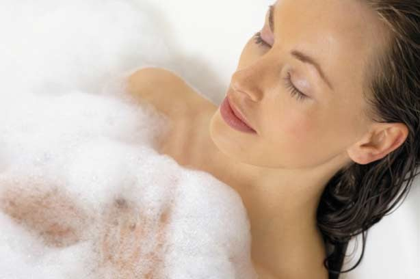 A woman relaxing in the bath