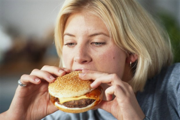 A woman eating a burger