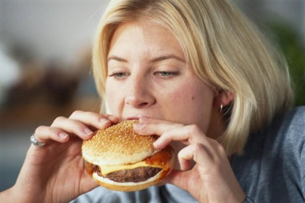A woman eating a burger