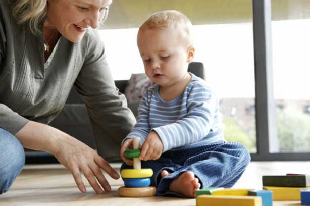 Child Rock woman play toys toddlers