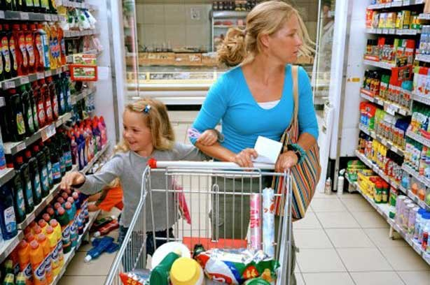 Primary going shopping supermarket child mother