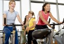 Women-on-exercise-bikes-taking-part-in-a-spin-class