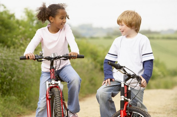 Pre-teen settling into a new neighbourhood children bikes exercise