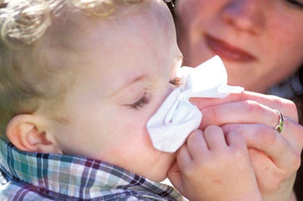 Toddler preventing a chapped face baby tissue cold