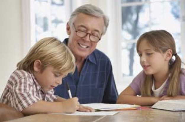 Grandgad helping kids with their homework