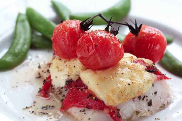 Roasted haddock with Cheshire cheese and vine tomatoes