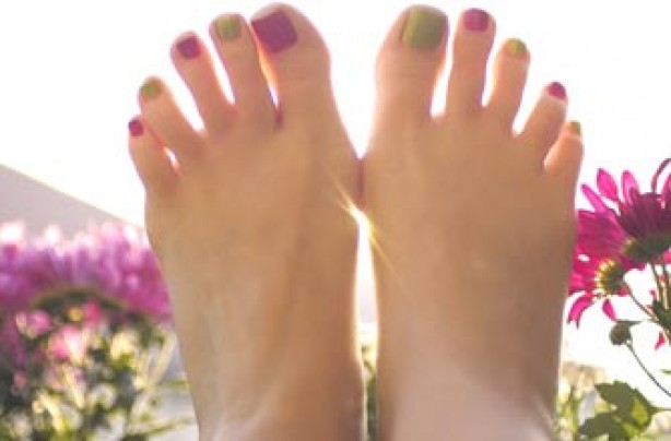 Woman's feet with painted toes