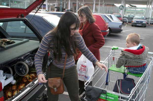 Supermarket parking woman shopping child trolley
