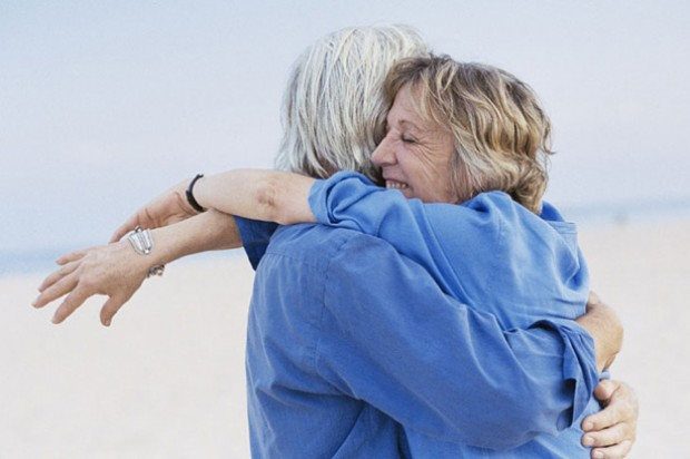 Relationships couple hugging mature elderly