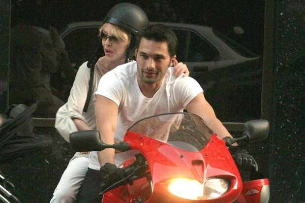 Kylie Minogue and Olivier Martinez on a red motorbike_Rex_Rights free