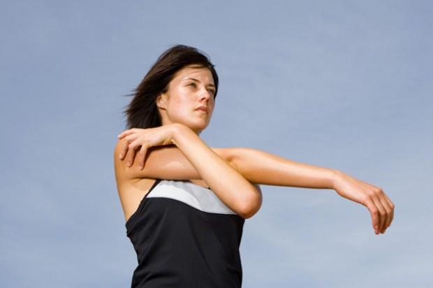 A woman stretching herr arm