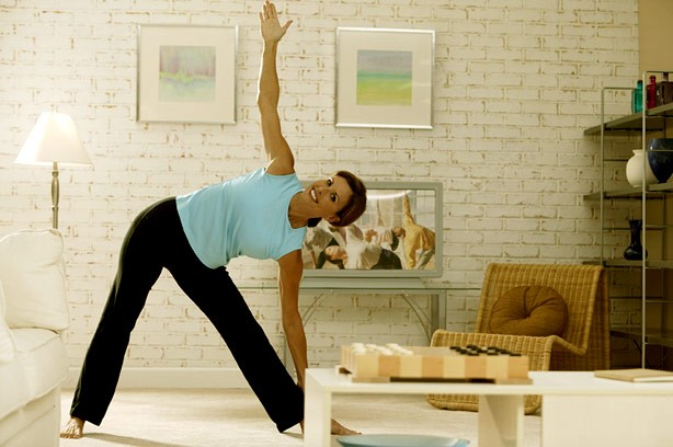 Woman trying Yoga at home