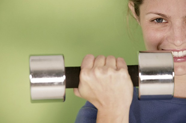 Woman holding weights indoors
