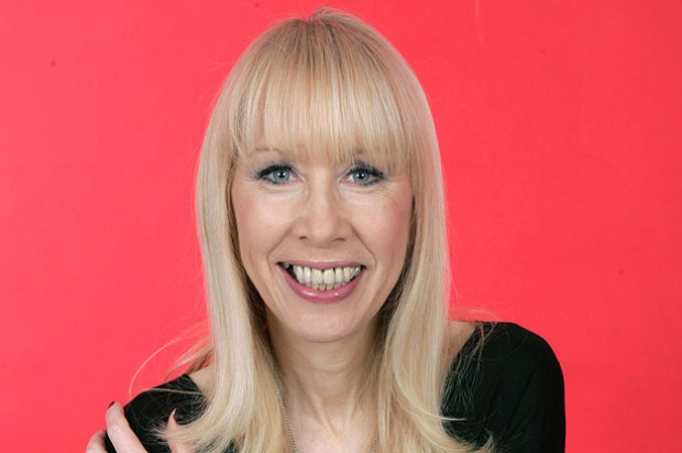 Judi James, sex and relationships expert, on a pink background