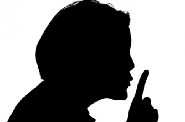 Silhouette of a woman saying Shhh!