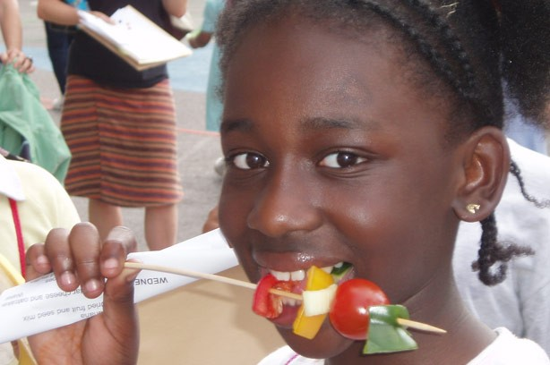 Girl eating vegetable kebab_school dinners campaign