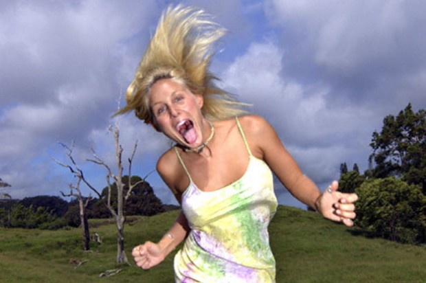 Woman running through field with mad face_J unlim