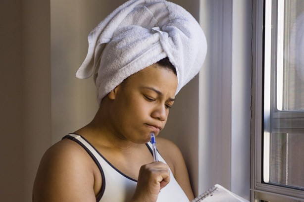 Woman thinking, woman in towel, woman with pen, quiz