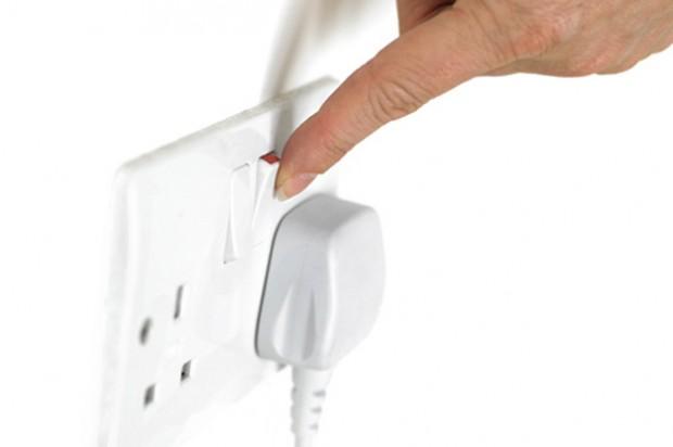 Person turning on plug