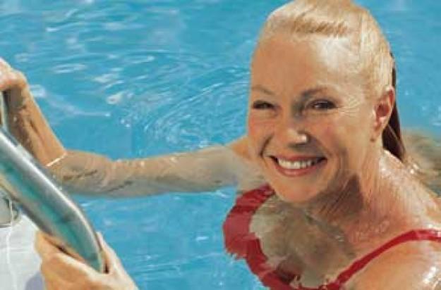 Lady swimming in swimming pool