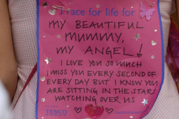 Sign pinned to a woman's back with a message for her mum