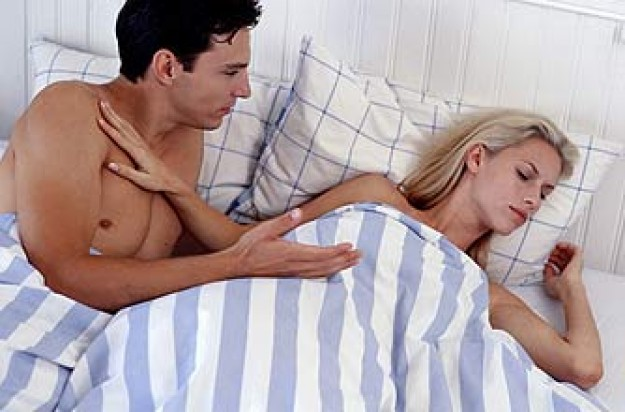 Couple in bed woman pushing man away_J unlimited