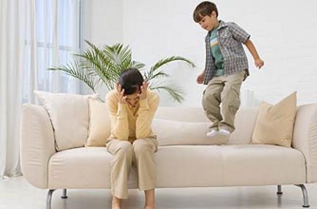 Child jumping on the sofa annoying his mother_ jupiter unlim