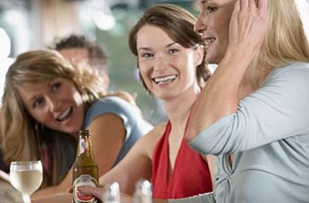 Women drinking beer and wine together