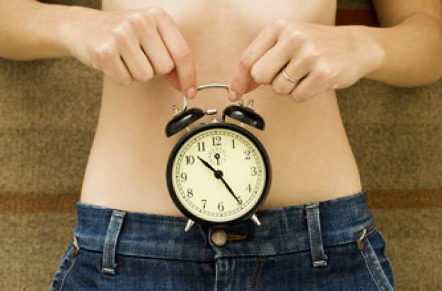 quick results diet, woman holding a clock