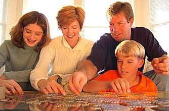 A family doing a jigsaw together