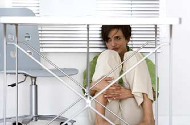 Phobias, the most common phobias, woman under a desk