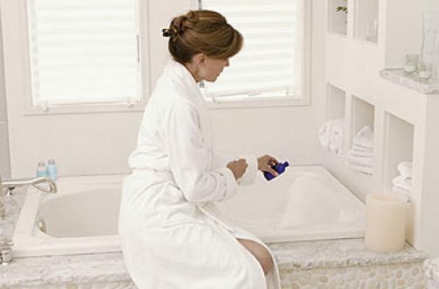 A woman running a bath