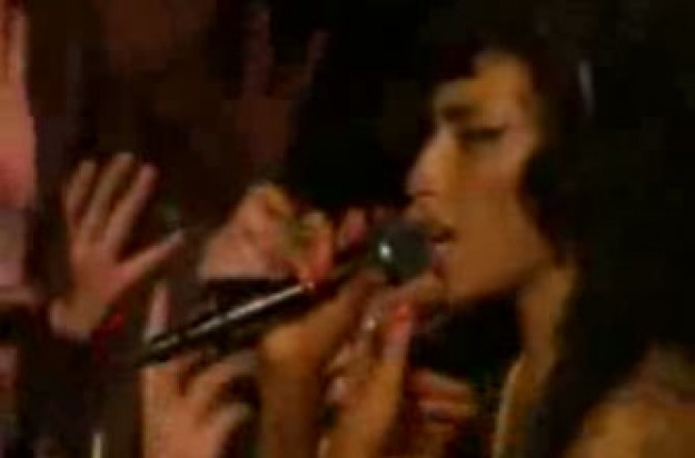 Watch Amy Winehouse punch a fan at Glastonbury