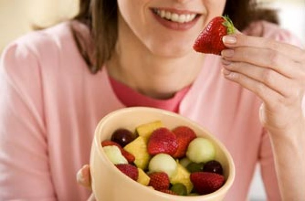 Woman with bowl of berries