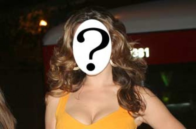 Kelly Brook has been caught chatting on her mobile phone while driving