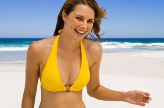 Woman on beach in bikini