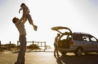 Dad and children in car by beach_rex